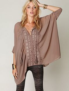 """Sheer oversized top with beautiful embroidered inset down the front center. Features braided tassel ties at the neck and a fluttery trapeze hem. Unlined.      *100% polyester  *Machine wash cold  *Import     Measurements for Size Small:  Length: 24 ½""""  Bust: 73 ½"""""""
