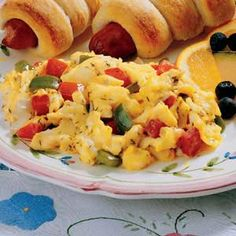 """Calico Scrambled Eggs  .....When you're short on time and scrambling to get a meal on the table, this recipe is """"eggs-actly"""" what you need. There's a short ingredient list, and cooking is kept to a minimum. Plus, with green pepper and tomato, it's colorful."""