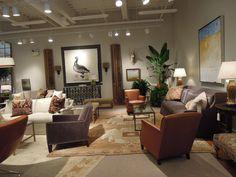 Lee Industries Showroom - oriental rug + gray sofa + warm accents