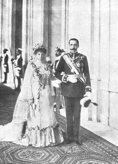 1901 (14 February) Prince Carlos of Bourbon Two Sicilies Princess Mercedes Asturias Spain at the end of their wedding ceremony..Infanta Mercedes is turned out in a stylish and lavish wedding dress with, at least, a lace veil and a lace flounce plus many flowers.