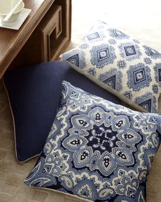 """Accent pillow collection offers intricate embroidered designs set off by a textured solid all in soothing shades of blue and white. Shown front to back: Floral Kaleidoscope, Willow Basketweave, and Geometric Diamond.Floral Kaleidoscope and Geometric Diamond pillows are linen with finely embroidered diamond design in shades of blue. 20""""Sq. Willow basketweave pillow is linen with a solid blue front, natural back, and natural piped border. 22""""Sq."""