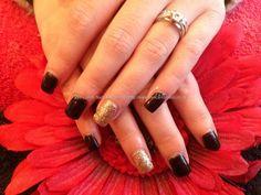 Acrylic nails with black n gold gel polish
