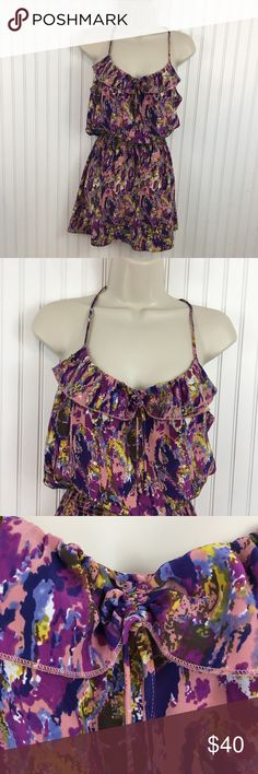 """Parker racerback 100% silk multicolored minidress Spaghetti straps with a racer back. Ruffled scoop neckline that is gathered in the front. Smocked waist all the way around. In very good condition no rips stains or holes Approximate measurements flat across Chest: 18"""" Waist: 9""""( elastic/smocked) Hips: 18.5"""" length: 33.5"""" Parker Dresses Mini"""