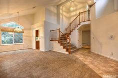 4007  Simi Valley Way,  Antelope, CA  95843.  Cascading stairway and formal dining and living rooms