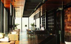 We are a global and creative design studio in Geneva, Tokyo and Beijing. Black Floor Lamp, Floor Lamps, Wicker Sofa, Black Sofa, High Chairs, Brick Wall, Hospitality, Creative Design, Sofas