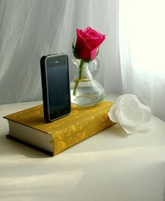 You can use a book to make an original iPhone charging station. You'll just have to feed the cord through the book and to make sure it's secure. It's a very fun project, perfect as a gift for a friend.{found on etsy}.