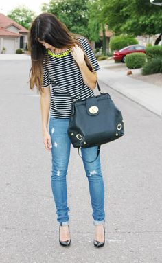 cute outfit! Love the purse :) striped top with neon necklace