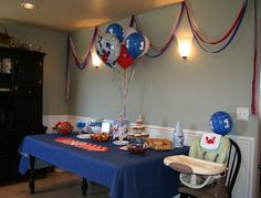 Nautical theme Birthday idea for baby's first birthday, plus activities for the baby guests.  From HappilyDomestic blog.