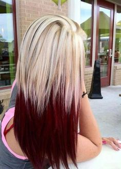 Blonde around the roots with brown strips, and beautiful red/burgundy color towards the ends from the middle!!