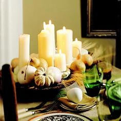 Add a touch of fall to your Thanksgiving table with elegant yet easy-to-make Thanksgiving centerpiece ideas. Including natural elements, candle displays, and more, these Thanksgiving decorations will be a highlight on your holiday table. Thanksgiving Table Centerpieces, Simple Centerpieces, Candle Centerpieces, Pillar Candles, Centerpiece Ideas, White Candles, Cream Candles, White Centerpiece, Holiday Centerpieces
