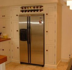 over the refrigerator ideas | American fridge housing with wine rack above overmantle / oven ...