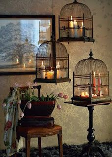 Candles in bird cages, I'm loving this idea. Now I need to search flea markets for old antique bird cages !!!!