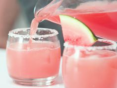 Watermelon Margaritas Recipe | Nothing says summer like a freshly cut slice of watermelon. This recipe from our friends at the National Watermelon Promotion Board does the sweet fruit justice in the form of a boozy, colorful cocktail on the rocks. And, it's not just made with watermelon juice – the chef created a watermelon simple syrup from seedless melon and sugar so that the bright, unmistakable flavor is in every sip of the drink. Combine the watermelon juice and watermelon simple syrup…