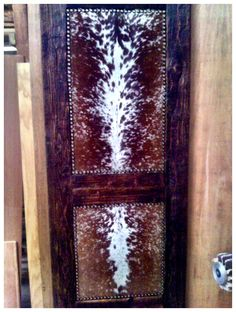 Custom doors with cowhide insets! We did every room in the house with a different hide! We used buffalo, cow, axis deer, and angora.