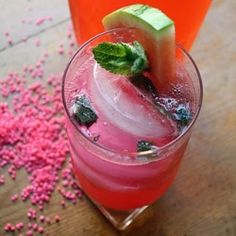 a refreshing cooler of fresh fruit and homemade watermelon vodka.  bright pink and bright flavor