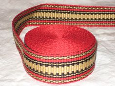 Red, gold, and black inkle woven trim. $40.00, via Etsy.