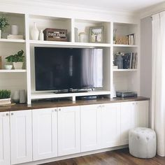 Still my favourite part of our house is the ikea wall unit but lately it's driving me crazy from the clutter. I'm considering ditching all… Living Room Built Ins, Living Room Wall Units, Ikea Living Room, Living Room Shelves, Ikea Tv Wall Unit, Built In Tv Wall Unit, Tv Wall Units, Wall Unit Decor, Ikea Wall Shelves