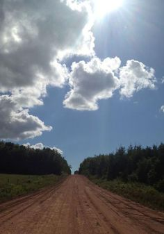 Big white clouds and red clay on Curtis Road, Prince Edward Island