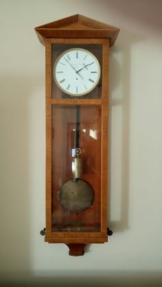 """Early Biedermeier style wall clock from the year 1820-1840, the so-called Dachluhr.Signed """"Joseph Freindorfer in Halas"""""""