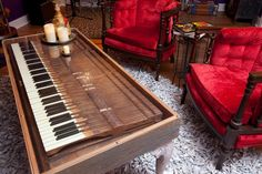This table was created by taking the keys of an old piano and placing them within a custom-made box, which was then attached to four repurposed table legs. By adding a glass top, the see-through surface has become a unique centerpiece as well as a functioning piece of furniture.
