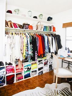 Closet organization with cubby shelves below & bag/hat storage above. | Glamour