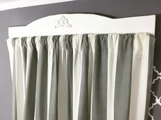 DIY Curtains rods in budget made from wood planks, decorated and painted. Easy and cheap way to hand curtains.