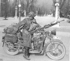 An Italian soldier in the fully-equipped motorcycle with a light machine gun Breda 30. France 1940.