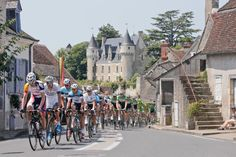 The pack passes Montresor Castle, rear, during the thirteenth stage of the Tour de France cycling race over 173 kilometers (108.1 miles), Friday. (Laurent Cipriani/AP)