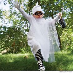 LOVE this idea for Eddie's ghost costume.  I can make the whole thing out of Kevin's old white t-shirts and then grab some netting from the fabric store.  <3  He's got the chuck's and I'd LOVE to find stripey socks!