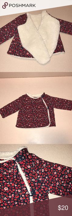Baby gap reversible jacket My absolute favorite jacket for my little girl! Super warm, one side is Sherpa like material the other side cotton with beautiful red and pink flower print.. worn either way it has 2 button closure.  Perfect for days when a bubble jacket is too heavy but u still need some warmth!  Inside Tags were removed. But it's from baby gap and is a size 6-12 month Loved but still in good condition! GAP Jackets & Coats