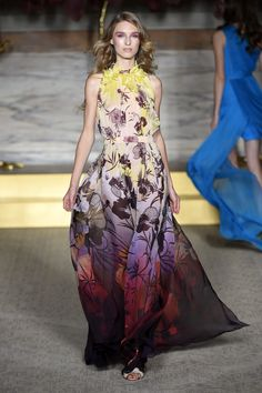 Hibiscus flowers tumble through from collar to hem. The Hibiscus Chiffon Evening Gown with embroidered neckline by Matthew Williamson