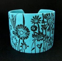"Wide Cuff Bracelet Polymer Clay Hand Stamped Art Jewelry Turquoise Flower Bracelet by PolymerPlayin,   This cuff bracelet is made entirely from polymer clay in a gorgeous shade of turquoise. Cuff has an intricate flower pattern impressed in the cuff that has been enhanced with hand painting. Has a silver plated clasp. Finished bracelet is 1.75"" wide and approx. 7"" around."