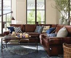 brown couch with blue accents