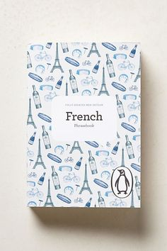 A book filled with useful words and phrases for someone planning a trip to a French-speaking country.