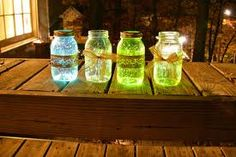 outdoor entertaining idea:  fill glass jars or mason jars with water and a glowstick to create instant lanterns -  love this simple DIY idea
