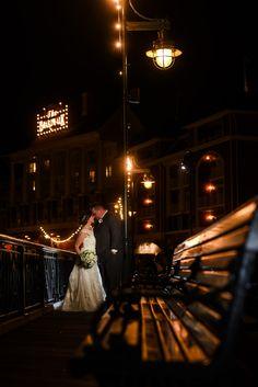 The pretty lights of Disney's BoardWalk illuminate this Walt Disney World wedding couple. Photo: Stephanie, Disney Fine Art Photography