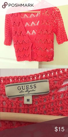 Adorable crochet cropped sweater size medium. Cute coral cropped short sleeved crochet sweater. Size medium. Guess brand. Excellent condition. Guess Sweaters Shrugs & Ponchos