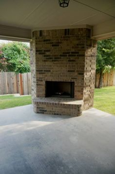 Outdoor living, large open porch, outdoor fireplace #mcbeehomes