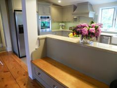 Presented by:  Renovisions, inc.  Hanover, MA  #cultivateit    Love this idea!  Bench seat built in to half way counter top.  Bench seat storage.  Can we do this from kitchen to family room?