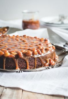 brownie cake with salted caramel and peanuts sauce.