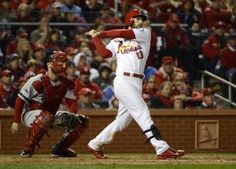 Matt Carpenter hits a RBI single against the Boston Red Sox in the 7th inning during game 4 of the 2013 WS. Cards lost the game 4-2 and series is tied 2-2. 10-27-13