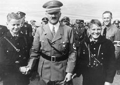 The Fuehrer visits a Hitler Youth training ground, meets with two young pioneers learning field tactics. The youths are elated. The Fuehrer is appropriately serious. In all, the magic flies thick.