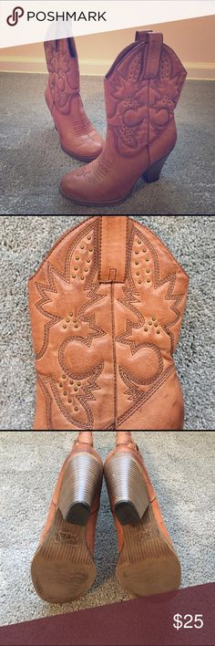 Detailed Cowboy boots These boots can be worn to your fav country bar or concert! At least that's where I wore them. Leather is in excellent condition. Hardly any wear and tear on heels. Boots are tan with brown detailed stitching. Shoes Heeled Boots