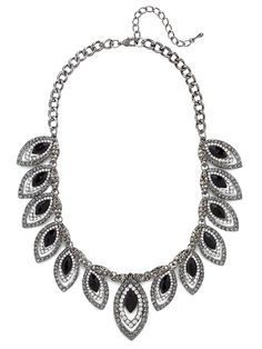 This collar is quite a site to behold.  With multiple evil eye-inspired charms covered in smoky colored gems this look is downright bewitchingly glam.