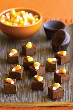 Dark chocolate and bitter orange offset the sweetness of candy corn in these fun but fancy truffles.#halloween #halloweenrecipes #myrecipes
