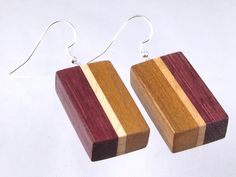 Handmade from natural wood free of dyes or stains. Large rectangle earrings in Purpleheart, Maple and Cherry on sterling silver ear wires. Wooden Earrings, Wooden Jewelry, Resin Jewelry, Jewelry Crafts, Woodworking For Mere Mortals, Cool Woodworking Projects, Wooden Boxes, Wood Art, Wood Crafts