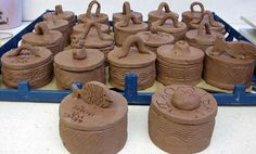 Lidded jars with textures.