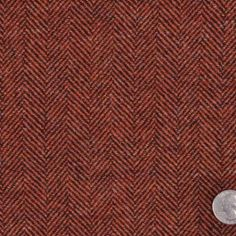 This is a medium weight wool herringbone. Has a medium hand but easy to work with. Great for suiting.