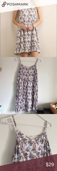"""Blue Floral Ruffle Dress Brand new without tag - order online and it came in without tag. Lightweight and flowy. Adjustable straps. 100% rayon. Measurement laying flat: bust: 20"""" length: 34/36"""" Colors are blue pink green brown cream Soieblu Dresses Midi"""