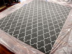 How to Stencil a Rug. I have the same grey rug and hate it. This may be a good way to extend the life...